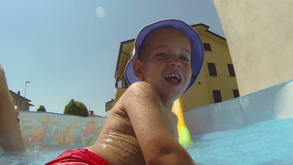 Little Boy Having Fun on Small Swimming Pool
