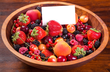 fresh berries in plate with blank card