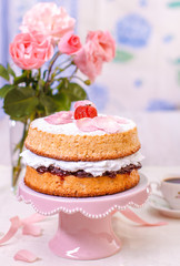 Victoria sponge cake with whipped cream and strawberries