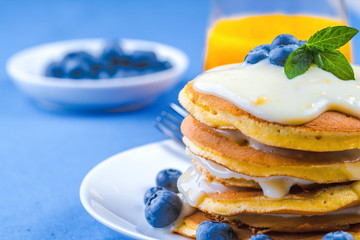 Pancakes with vanilla sauce and blueberry