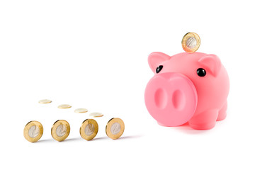 Piggy bank and coins isolated