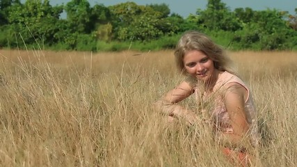 Young girl on grass.