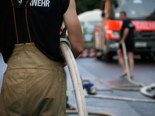 Firefighter with a fire hose