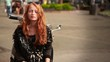 Cute girl with red hair and the old motorbike