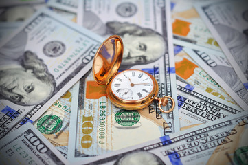 Money and antique watch