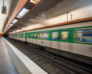 Paris subway station with speeding train blur, France