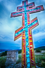 Stained glass orthodox cross symbol closeup