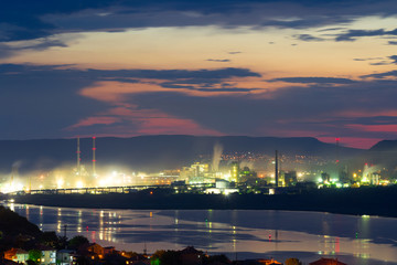 Sea port factory at night panorama