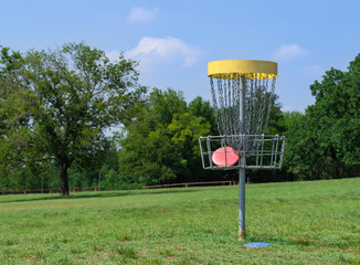 Disc golf basket in a park