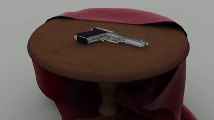 テーブルに銃