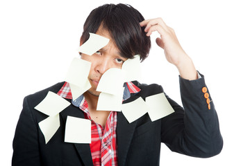 Asian office man covered in blank notes