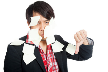 Asian office man covered in blank notes with his thumbs down