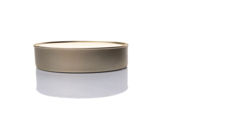 Oval shaped tin can over white background
