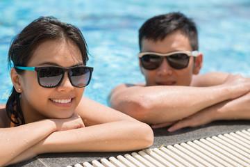 Relaxing in resort pool