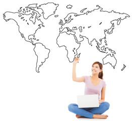 smiling young woman sitting and drawing global map