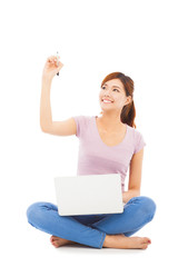 smiling young woman drawing with a laptop