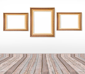 Set of gold vintage picture frames on the wall