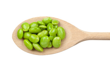 Green soybeans on wooden spoon isolated on white