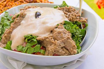 fresh chopped tuna salad on a white plate