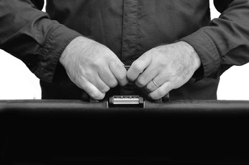 Hands of a man carry travel suitcase