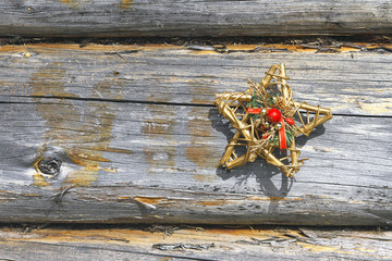Decorative star and wooden wall