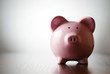 Pink piggy bank on a colorful grey background