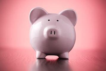Pink piggy bank on a colorful red background