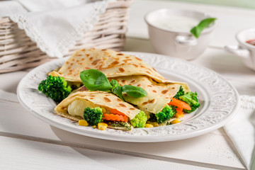 Pancake with vegetables and three sauces