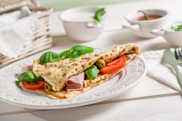 Pancake with vegetables and ham