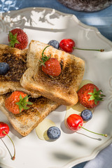 Toast with fruit and honey served in the garden