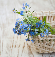 Bouquet of spring flowers in basket