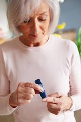 Senior Female Diabetic Checking Blood Sugar Levels