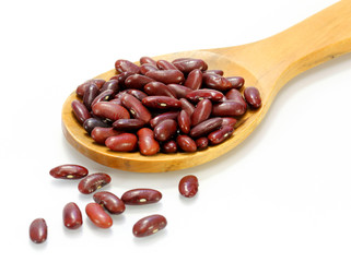 Kidney beans in a wooden cooking spoon