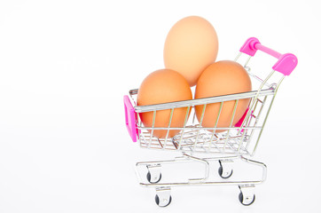Eggs in the shopping cart on white background
