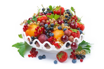 dish with seasonal fruit and berries, isolated