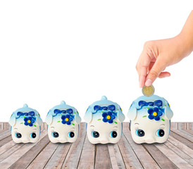 Money Saving with Piggy bank on wood background