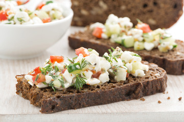rye bread with cheese and vegetables, close-up