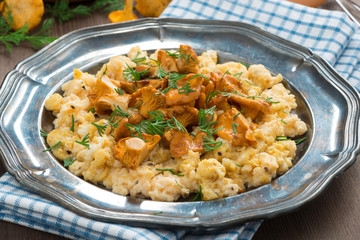 scrambled eggs with chanterelles and herbs, close-up