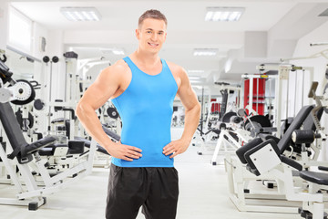 Young male athlete posing in a gym