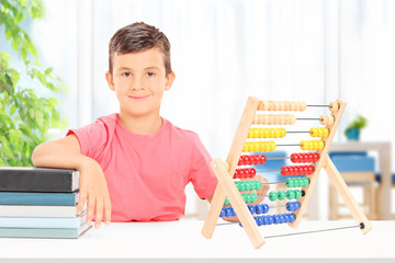 Boy counting on an abacus at home