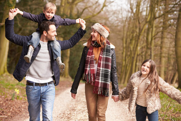 Family On Winter Countryside Walk Together