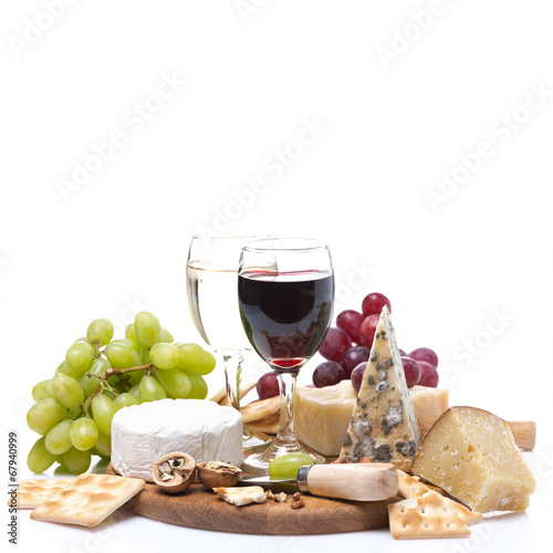 two glasses of wine, grapes, cheese and crackers, isolated