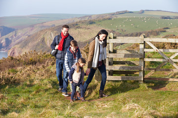 Family Walking Along Coastal Path