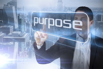 Businessman presenting the word purpose