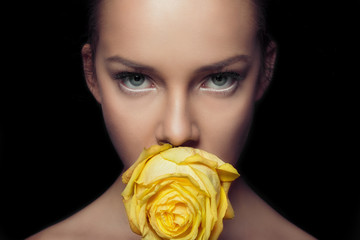 Charming face with rapier glance. Yellow rose.
