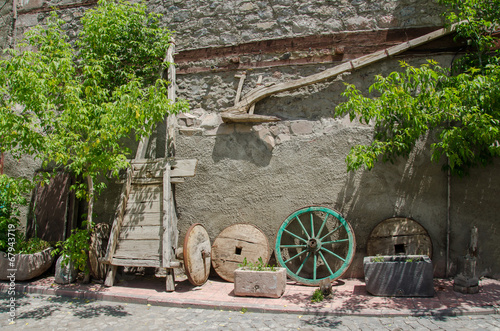 Old wood plow, tumbrel and wheels