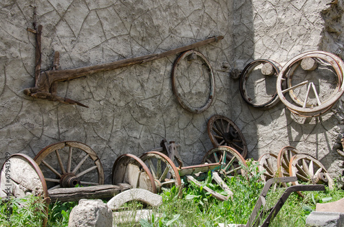 Old wood plow and wheels
