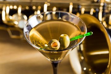 saxophone and martini with green olives