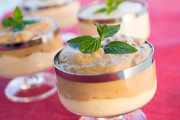 cream dessert with peppermint leaf
