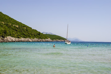 Bay in Montenegro - sailboat and swimmers